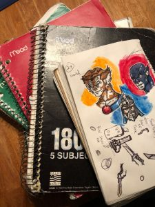notebooks on the floor with art